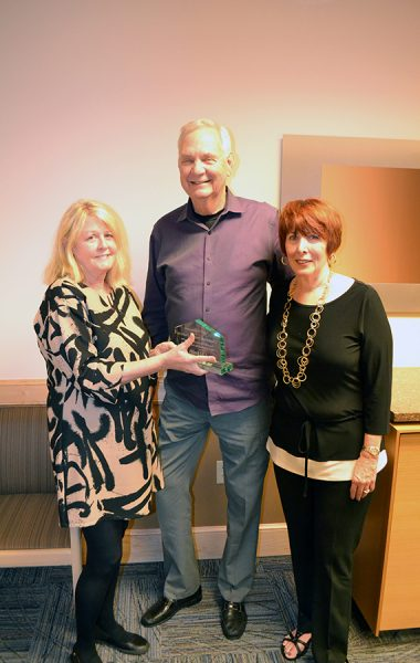 (Left) Jean Osbrach, LCSW, a UF Health Shands Hospital Patient and Family Resources case management specialist, presented Charles and Jeanette Prellwitz with a plaque honoring their contributions to the Shands Samaritan Lodging Fund.