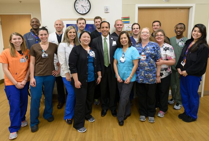 Ed Jimenez gathered with faculty and staff during a visit to the UF Health Shands Emergency Center at Springhill.
